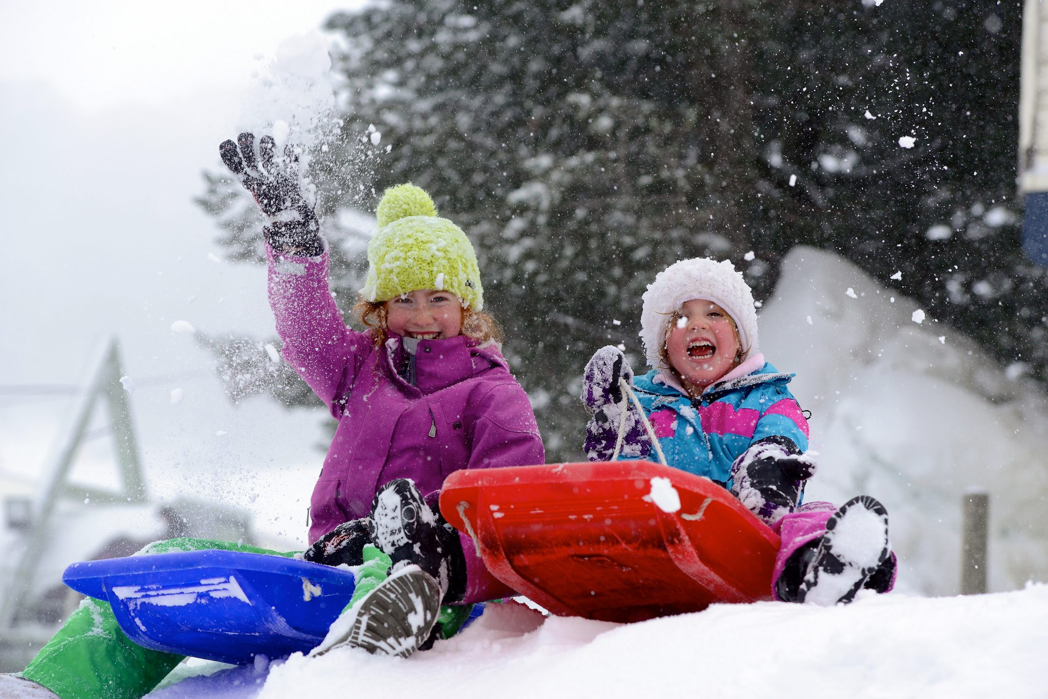 Grace Walkley 10 & Ava Moegel 5,  enjoy the 20cm+ of new snow at Falls Creek today. Snow was reported to fall as low as 300m above sea level. Temperatures dipped to minus 7C. Skiers enjoyed the best powder snow conditions of the record breaking 2014 snow season.